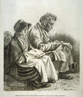 Man and woman seated outdoors