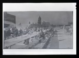 Untitled (Hot meal kitchen on outer Market Street with a silhouette of the City Hall in the background)
