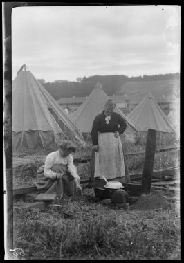 Untitled (Two women working at their temporary stove in a refugee camp)