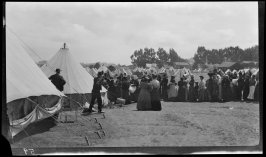 Untitled (Families in line for aid in the army emergency camps)