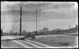 Untitled (Ruins with debris cluttered streets and hanging telephone wires)