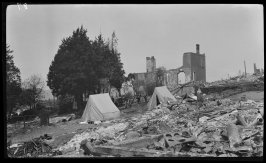 Untitled (Two tents stand among the debris and ruin left by the earthquake and fire)