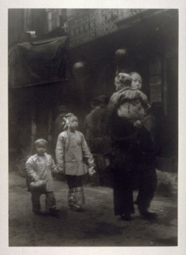Untitled (Woman walking on the street with three children, one in her arms) from the Chinatown Series