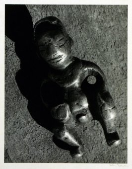 """Brass pendant, 2"""" high, worn by tribespeople of Western Yunnan as a charm."""