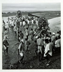 A Durgha festival at Dibrugarh, Assam, terminates in a frenzied procession to the banks of the Brahmaputra from where images of the goddess are carried out on boats and sunk to the bottom of the great river.