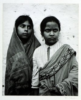 Though belonging to the lower class these serious looking South Indian girls wear sari, earrings, and jewel pierced into the nostril, emblems of all Indian womanhood.