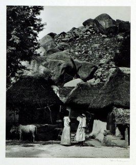 Village in granite rocks near Chittoor, Madras Province. Houses are made of bamboo and mud with rice thatch roofs.