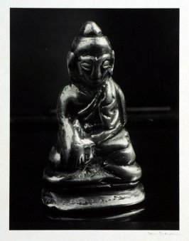 "Meditating Buddha, probably Tibetan, brass and gold two "" high. The image is well worn off by rubbing it in hand as charm for good luck."