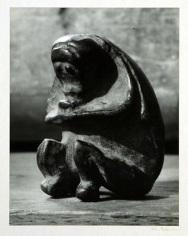 "Seated monkey, carved from a peach stone, one"" high, Yunnan?"