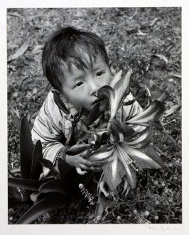 Child with gladiolas.