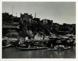 The town of Chenchi in Hunan Province is built on the rocky banks of the Yuan River where many of its inhabitants live in houseboats. Soldiers and civilians are seen ferrying the stream from and to the markets.