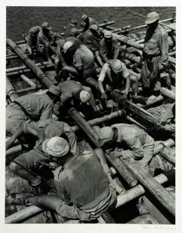 Chinese engineers of the New Sixth Army constructing a pontoon bridge made of casoline drums, bamboo and native-made rope. 1944