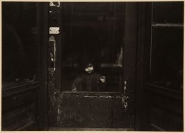 Untitled (Small Child Looking through Glass Panel Door)
