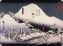 Shops at Mariko Selling Tororo Soup and a Distant View of Mt. Fuji (Mariko utsunoyama embo meibutsu tororojiru), no. 21 from the series Fifty-three Stations of the Tokaido (Tokaido gojusantsugi no uchi)