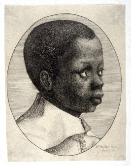 Head of a young black boy in profile to right in an oval