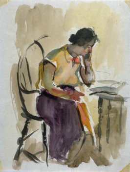 Study : woman seated at a table reading