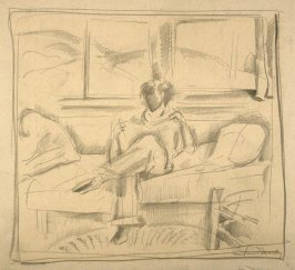 Study : man sitting on a couch raeding.