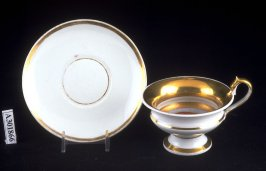 Cup and saucer with cupids