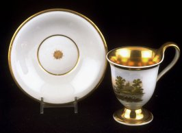 Cup and saucer with boating scene