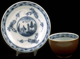 Cup and saucer with Chinese designs