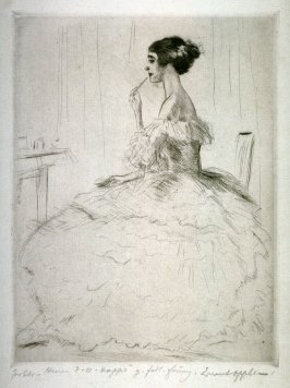 Woman at her dressing table using lipstick