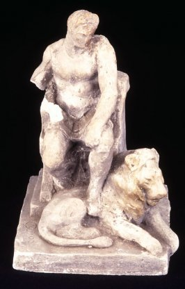 Victory (seated male, foot resting on lion)