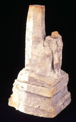 Man leaning against monument