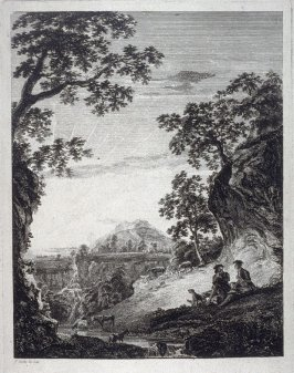 Two men seated on a hillside