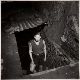 Boy Emerging From Cellar, Germany