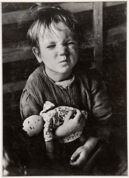 A child from the Sudeten region of Czechoslovakia with a homemade doll