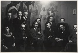 """Henri Barbusse, center, surrounded by leading left-wing intellectuals in the office of his new literary journal, """"Monde."""" Paris, 1935"""