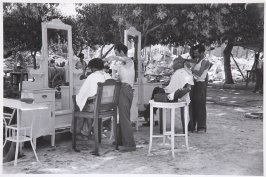 Outdoor barbershop opens for business after the earthquake, Greece