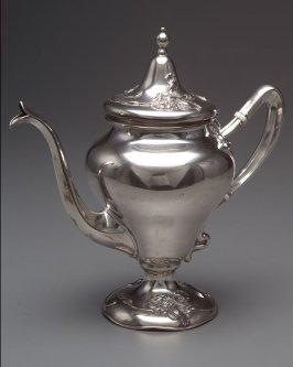 Teapot with attached cover