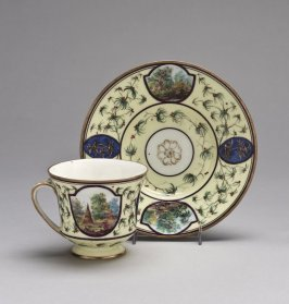 Cup and saucer, pale yellow ground with split handle