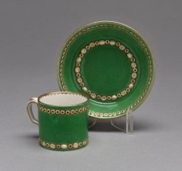 Jewelled cup and saucer, green ground