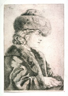Young man with fur cap