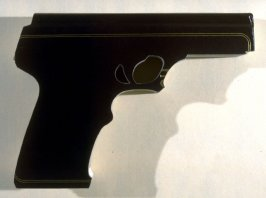 Untitled (Bible, cut with a band saw in the shape of a handgun)