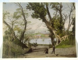 House on Lake with Boy and Man in Foreground