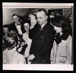Lyndon Johnson Taking Presidential Oath Next To Mrs. Kennedy