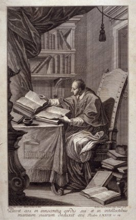A Cleric pores over his books.