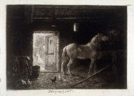 Interior of a barn with a horse