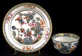 Cup and saucer with floral design