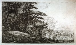 [Landscape: Small village to the left of trees]