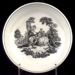 "Saucer with print of ""L'Amour"""