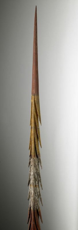 Throwing spear - red handle with red, yellow, and white spikes