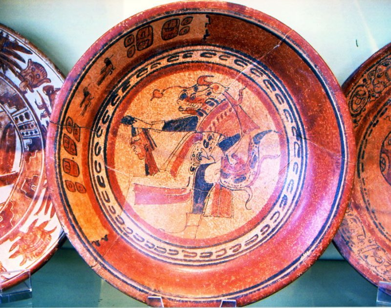 Plate with standing figure holding decapitated head