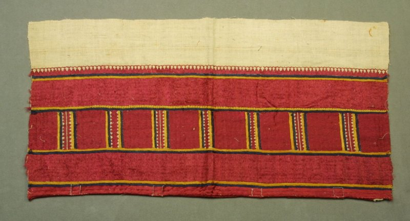 Fragment : of embroidery, all over design of red silk rectangles and white cotton ground