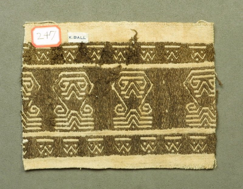 Fragment:, brown cotton embroidery on coarse white cotton ground, geometric forms