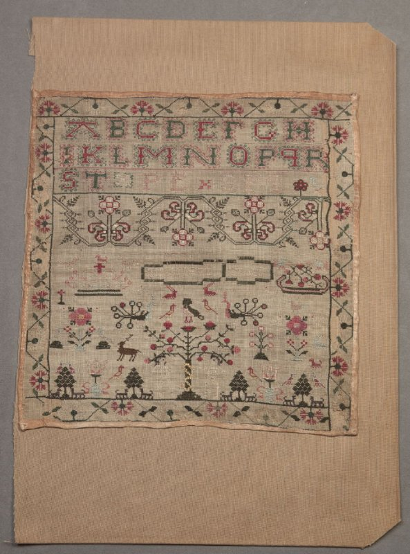 Sampler: red and green on beige, with trees and animals