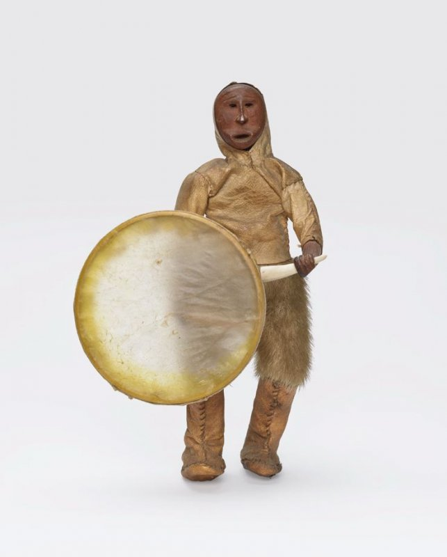 Figure with drum